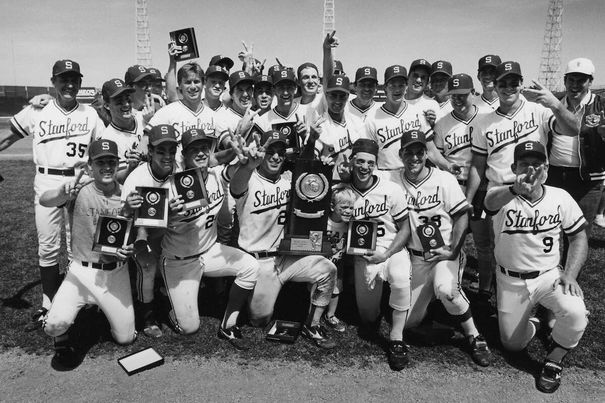 Head coach Mark Marquess (9) and his players and coaches celebrate the Cardinal's second straight College World Series title after beating Arizona State.