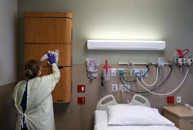 A worker cleans a room at Regional Medical Center. Photo: Justin Sullivan/Getty Images / 2020 Getty Images