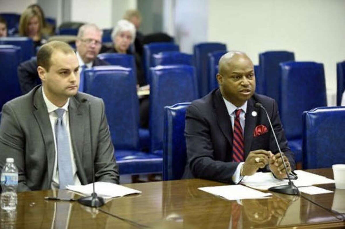 """Edwardsville attorney Dustin Maguire, left, and State Rep. Emanuel """"Chris"""" Welch testified at a House committee hearing in favor of House Bill 3904, which would allow college athletes to hire agents and make money through endorsements. The bill passed the House but has not yet been called for a vote in the Illinois Senate."""