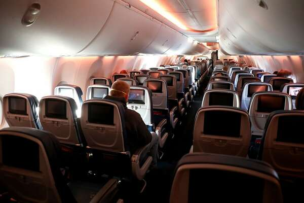 Passengers are seen in a cabin mid-flight on a Baltimore, Maryland bound Delta flight from Hartsfield-Jackson Atlanta International Airport on April 20, 2020 in Atlanta, Georgia. (Photo by Rob Carr/Getty Images/TNS)
