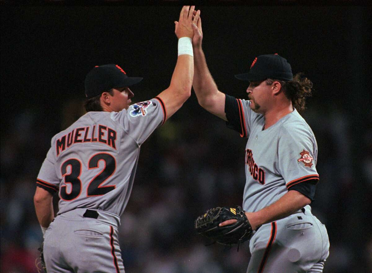 ADVANCE FOR WEEKEND EDITIONS AUG. 30-31--FILE--San Francisco Giants closer Rod Beck, right, is congratulated by teammate Bill Mueller after Beck pitched the ninth inning and secured the Giants' 4-3 win over the Texas Rangers in this June 12, 1997photo, in Arlington, Texas. After five long months, pennant races often come down to one man: the closer. In the next four weeks, bullpens will determine which teams will be playing in October. (AP Photo/Linda Kaye)