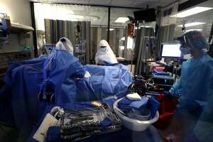 Nurses clean up after being part of a team that performed a procedure on a coronavirus COVID-19 patient in the intensive care unit (I.C.U.) at Regional Medical Center on May 21, 2020 in San Jose, California. Frontline workers are continuing to care for coronavirus COVID-19 patients throughout the San Francisco Bay Area. Santa Clara county, where this hospital is located, has had the most deaths of any Northern California county, and the earliest known COVID-19 related deaths in the United States.