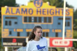 Alamo Heights High School volleyball player Ella Sanders stretches during the school's first conditioning camp at Orem Stadium, Monday, June 8, 2020. With coronavirus concerns, the school held three camps with about 120 athletes each and to observed social distancing those were broken into pods of 15.