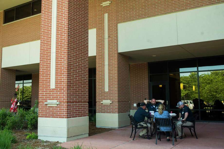 MidMichigan Medical Center-Midland staff enjoy lunch outside Monday afternoon. During last month's flood, the hospital's main kitchen and cafeteria lost power, which is expected to be restored in the next few weeks. (Katy Kildee/kkildee@mdn.net)