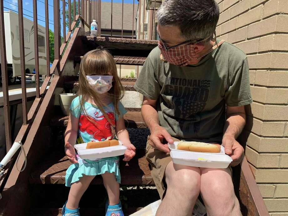 People of all ages enjoyed hot dogson Saturday, June6 at lunchtime through Open Door's soup kitchen. (Photo provided)