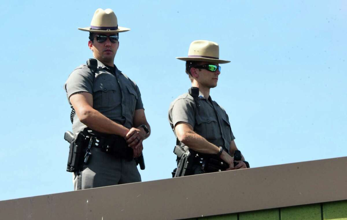 New York State Troopers are seen on top of the state police barracks as Shenendehowa High School students and others take part in a Black Lives Matter march from Clifton Common to the State Police barracks and back on Monday, June 8, 2020 in Clifton Park, N.Y. (Lori Van Buren/Times Union)