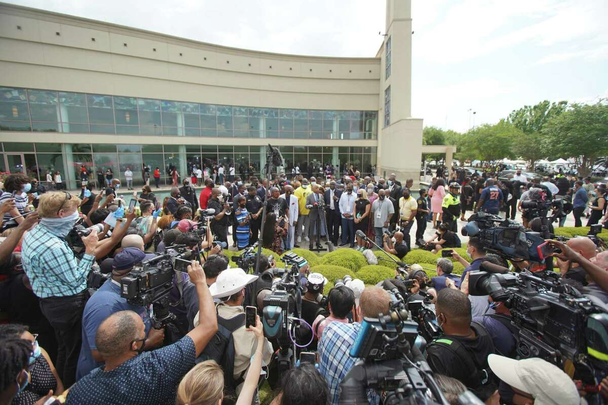 The Rev. Al Sharpton speaks to reporters outside of the public viewing for George Floyd on Monday, June 8, 2020, at The Fountain of Praise Church in Houston.