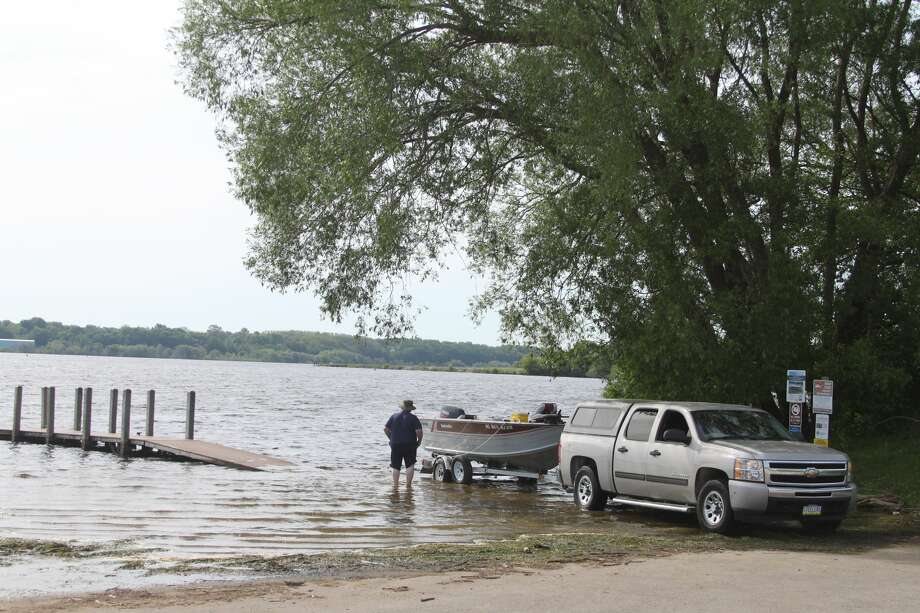 Manistee Lake levels are at extremely high levels and have flooded part of the Arthur Street Boat Launch area. As little as three feet or less of shoreline is left between the Lake Michigan shoreline banks and the water in several areas in the stretch of beach. Photo: Ken Grabowski/News Advocate