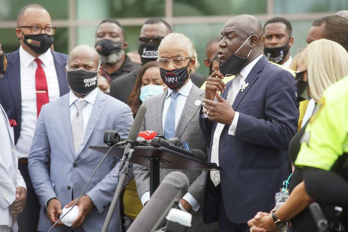 The Rev. Al Sharpton and civil rights attorney Ben Crump speak to reporters outside of the public viewing for George Floyd on Monday, June 8, 2020, at The Fountain of Praise Church in Houston.