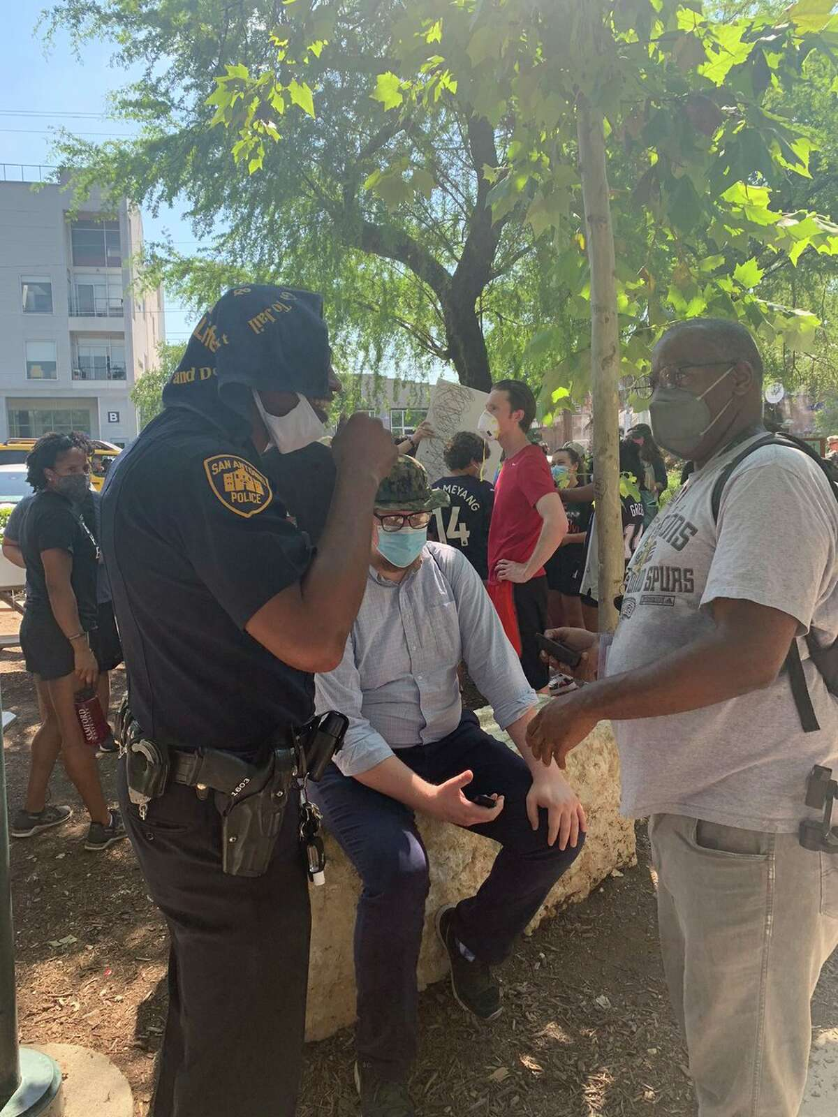 Officer Doug Greene, public information officer with the San Antonio Police Department, meets with protesters Monday, June 8, 2020, at Blue Star Arts Complex.