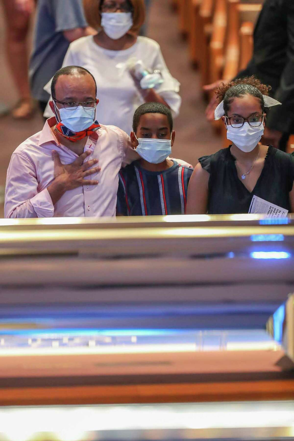 Mourners view the casket of George Floyd during a public visitation Monday, June 8, 2020, at The Fountain of Praise church in Houston. Floyd died after being restrained by Minneapolis Police officers on May 25.
