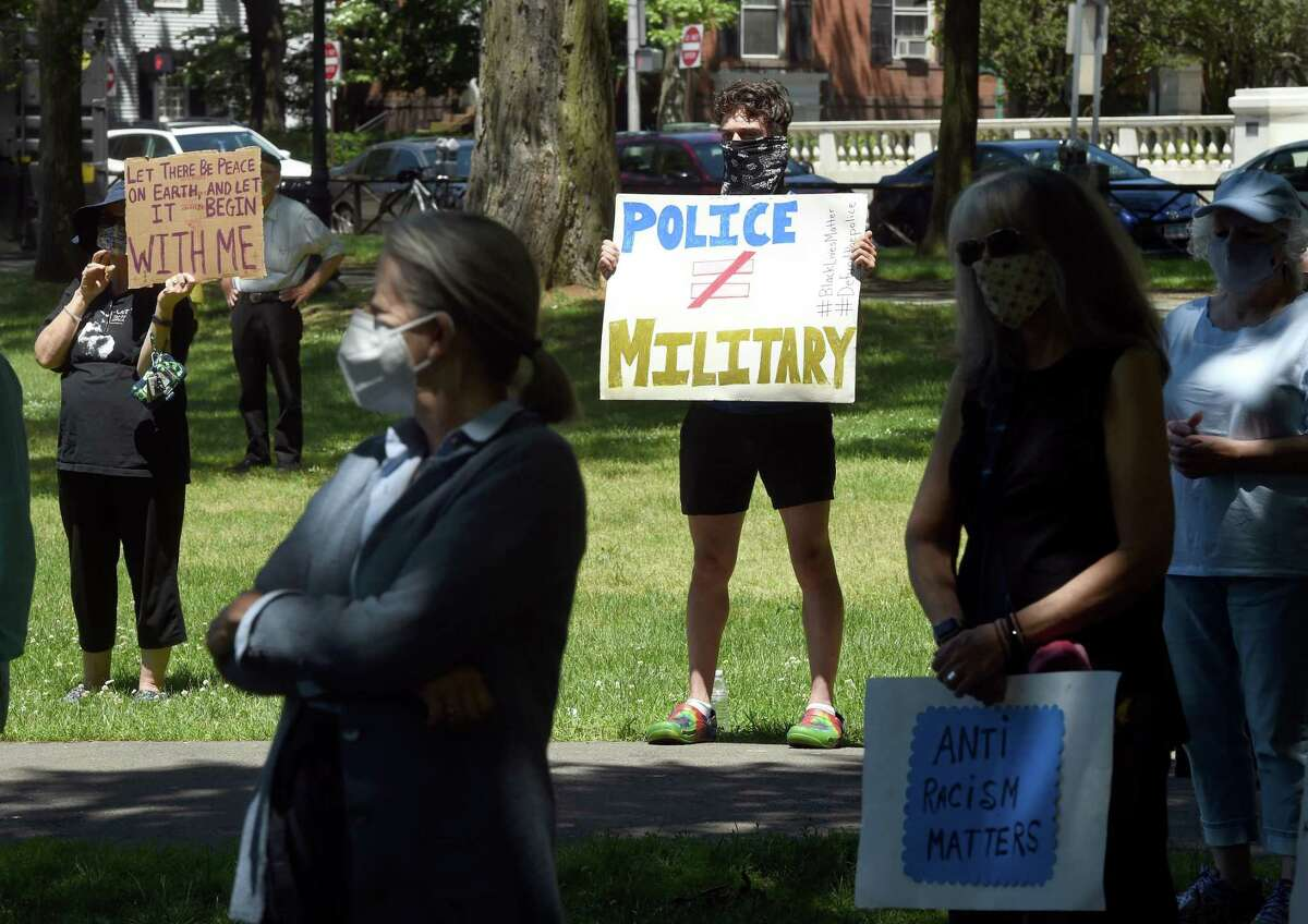 Evan Gambandella, center, of North Haven joined his grandmother, Alicia Clapp, to participate in an elder protest to support black lives, oppose police brutality and support institutional change on the New Haven Green on June 8, 2020.