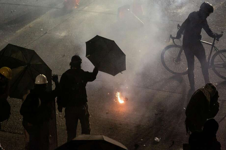 SEATTLE, WA - JUNE 08: A percussion device thrown by police lands near demonstrators as they clash with law enforcement near the Seattle Police Departments East Precinct shortly after midnight on June 8, 2020 in Seattle, Washington. Earlier in the evening, a suspect drove into the crowd of protesters and shot one person, which happened after a day of peaceful protests across the city. Later, police and protestors clashed violently during ongoing Black Lives Matter demonstrations following the death of George Floyd. (Photo by David Ryder/Getty Images) Photo: David Ryder, Getty Images