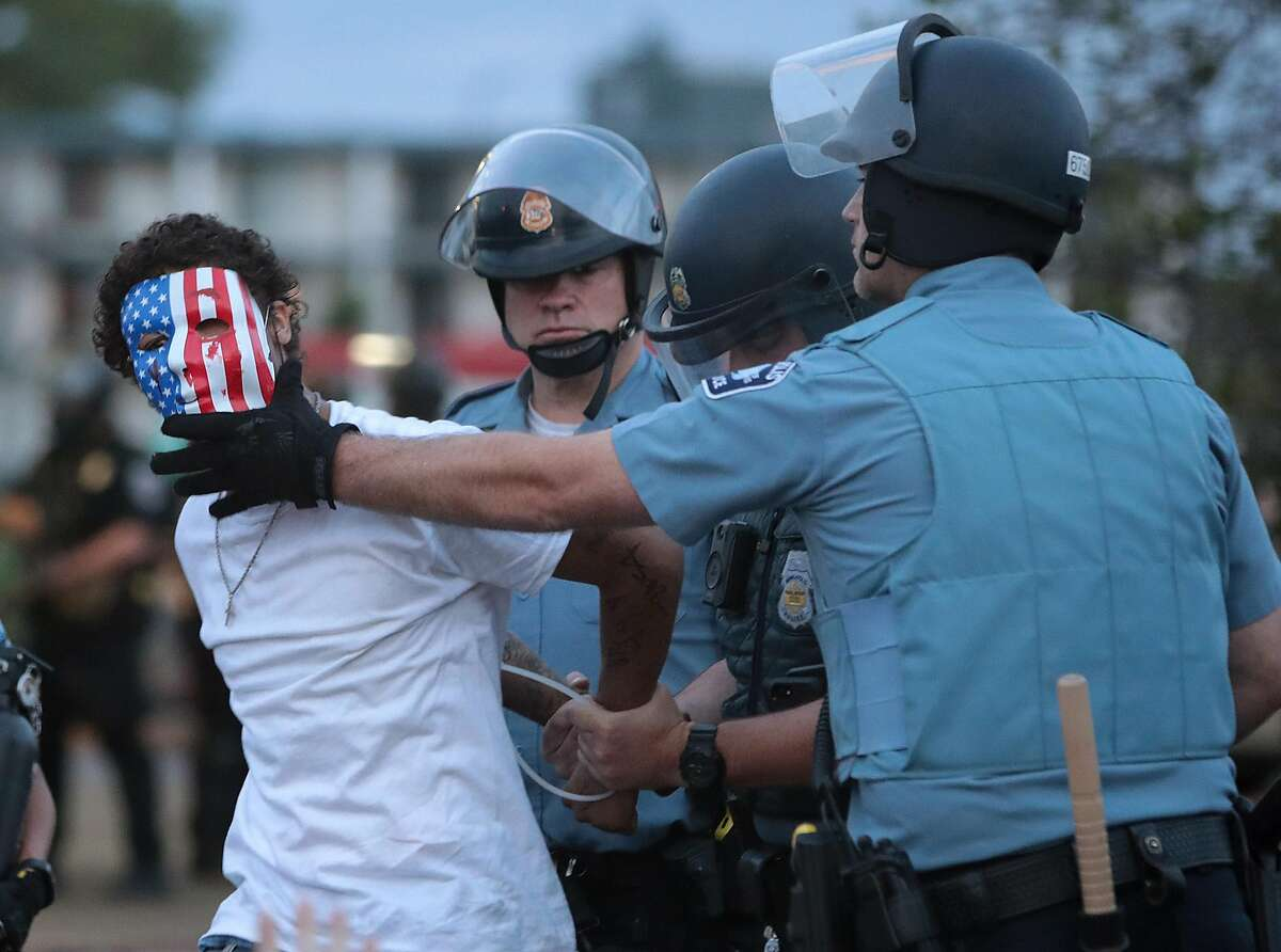 A demonstrator is arressted during a protest against police brutality and the death of George Floyd, on May 31, 2020 in Minneapolis, Minnesota. Protests continue to be held in cities throughout the country over the death of George Floyd, a black man who died while in police custody in Minneapolis on May 25. (Scott Olson/Getty Images/TNS)