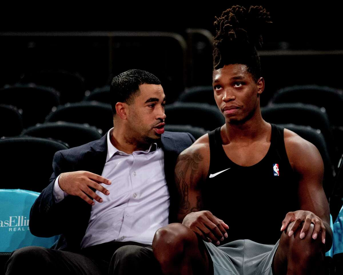 San Antonio Spurs general manager Brian Wright talks to guard Lonnie Walker IV during warmups before the game against the New York Knicks at Madison Square Garden on Nov. 23, 2019.