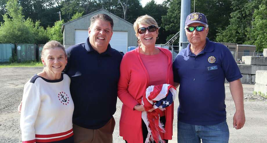 State Reps. David Rutigliano, R-123, Laura Devlin, (R-134) and Ben McGorty, R-122, in cooperation with the Trumbull American Legion Post #141 will be hosting a social distancing flag collection at the Middlebrook Elementary School on Saturday June 13, from 9-11 a.m. Pictured are: Suzanne Burr Monaco, David Rutigliano, Laura Devlin and Ernie Foito, Commander of American Legion Post #141. Photo: Contributed Photo