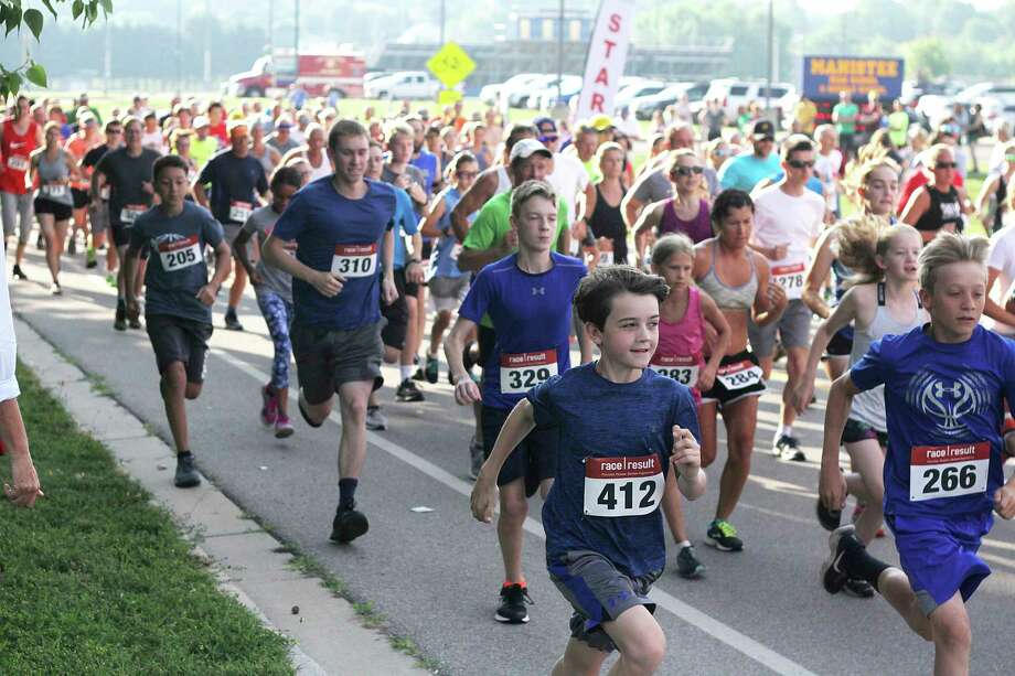Runner's compete in last year's Firecracker 5K. The race will be held virtually this year due to the coronavirus pandemic. (News Advocate file photo)