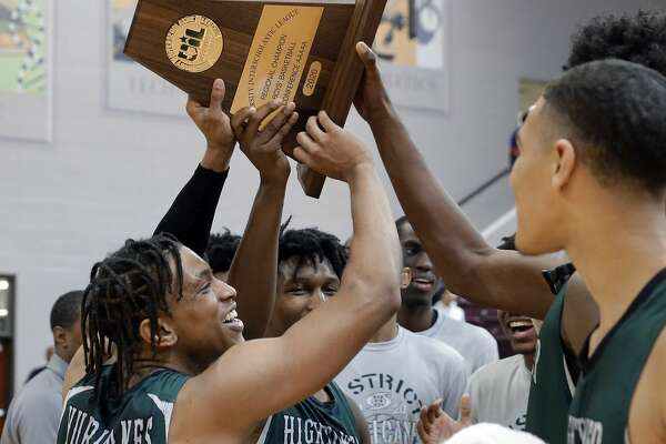 Hightower players hoist the trophy after defeating Shadow Creek in the Class 5A Region III finals basketball game, held at the M.O. Campbell Education Center Saturday, Mar. 7, 2020 in Houston, TX.