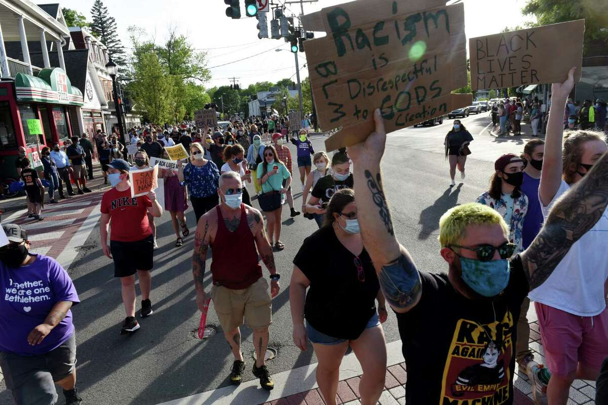 Demonstrators march down Delaware Avenue from the Four Corners during a vigil to protest against police brutality and inequality in the wake of the death of George Floyd on Monday, June 8, 2020, in Delmar, N.Y. (Will Waldron/Times Union)