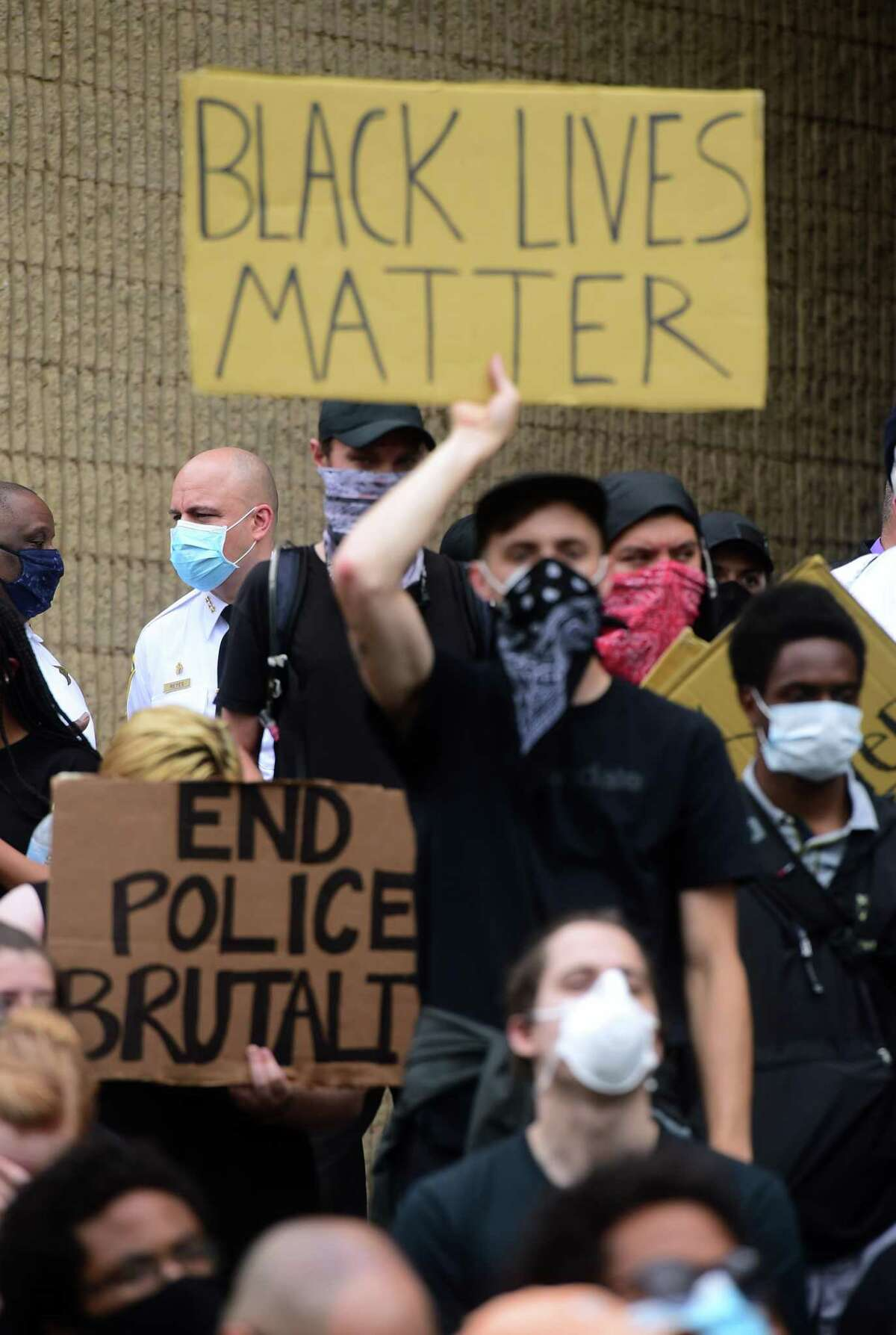 People listen to youth speakers in front of the New Haven Police Department during a protest against police brutality and the killing of George Floyd organized by the Citywide Youth Coalition and Black Lives Matter New Haven on June 5.