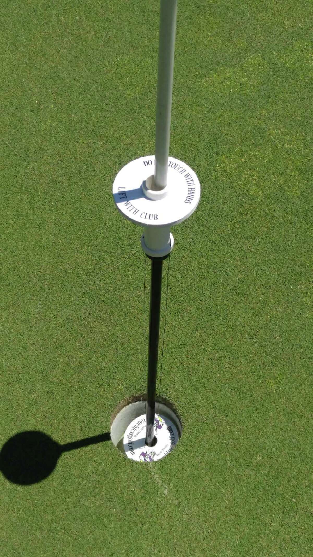 A ball-retrieving device, enabling players to remove their golf ball from the hole without touching the flagstick, was employed Monday, June 8, 2020, during the Northeastern New York PGA Pro-Pro at Waubeeka Golf Links in Williamstown, Mass. Because of the COVID-19 pandemic, this marked the section's first event of the season. (Pete Dougherty/Times Union)