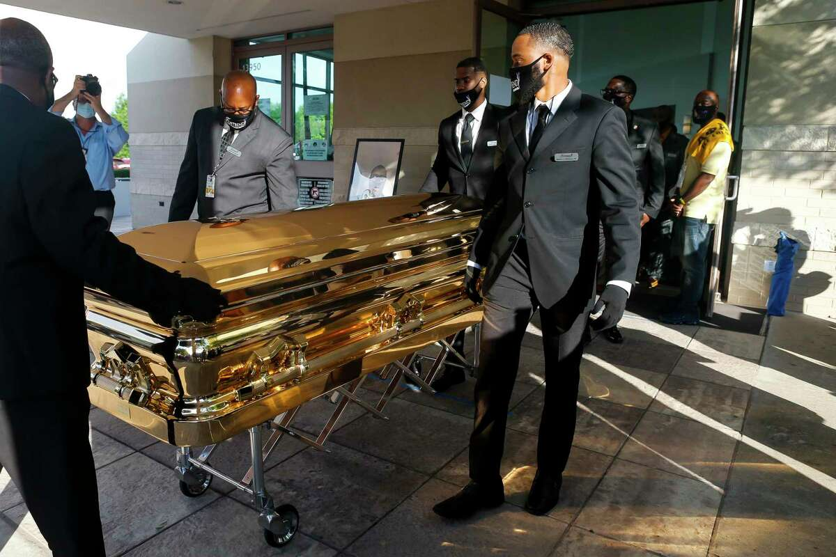 George Floyd's casket is brought out of The Fountain of Praise church following a public visitation Monday, June 8, 2020, at The Fountain of Praise church in Houston. Floyd died after being restrained by Minneapolis Police officers on May 25.