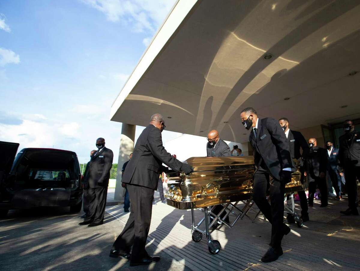George Floyd's casket leaves the building after a public memorial for him Monday, June 8, 2020, at The Fountain of Praise Church in Houston.