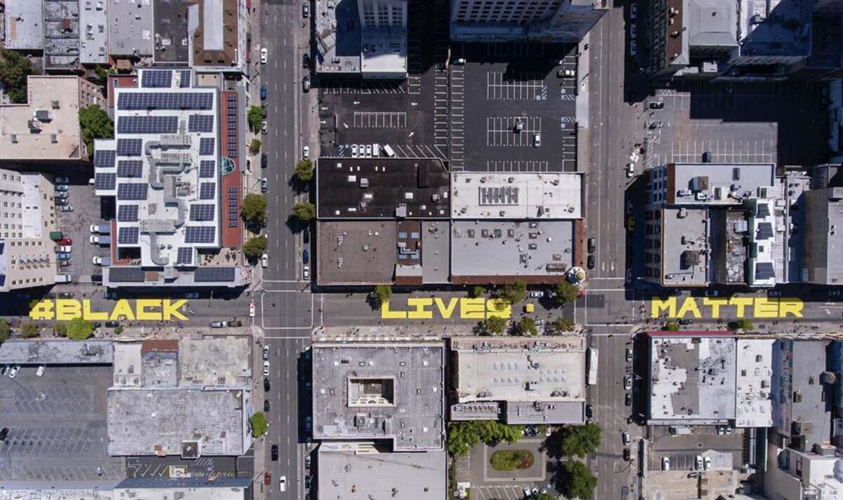 An overhead view of a massive street mural in Oakland promoting