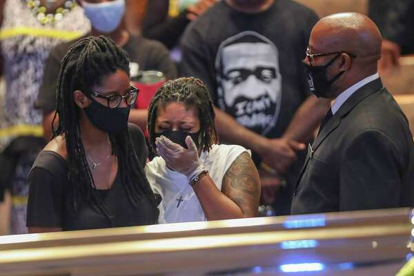 Mourners react as they view the casket of George Floyd during a public visitation Monday, June 8, 2020, at The Fountain of Praise church in Houston. Floyd died after being restrained by Minneapolis Police officers on May 25.