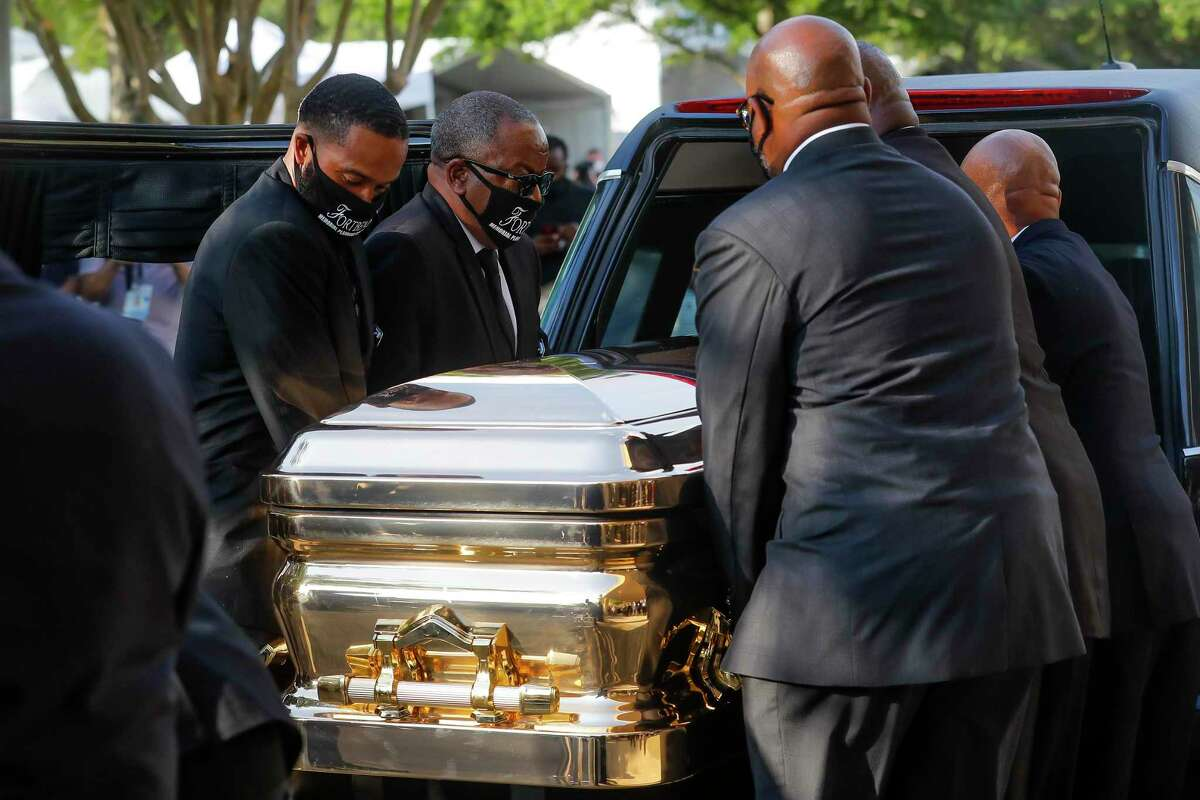 George Floyd's casket is loaded into a hearse after being brought out of The Fountain of Praise church following a public visitation Monday, June 8, 2020, at The Fountain of Praise church in Houston. Floyd died after being restrained by Minneapolis Police officers on May 25. (Godofredo A. Vásquez, Houston Chronicle via AP, Pool)