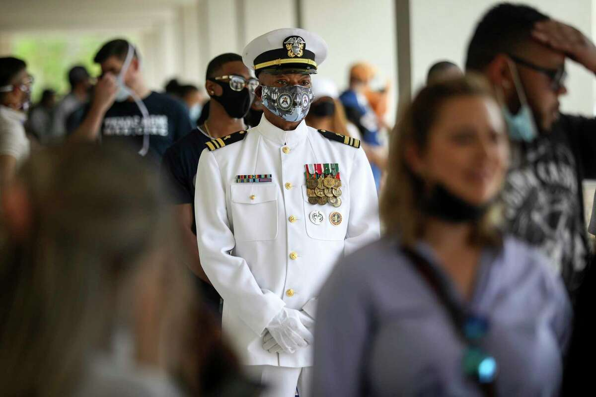 """Gregory McCrimmon, who asked to give his name as """"I can't breathe,"""" waits to attend a public viewing for George Floyd on Monday, June 8, 2020, at Fountain Life Center in Houston. McCrimmon is a retired Navy chaplain. """"That's the evidence of injustice,"""" he said of Floyd's body in the church. """"I'm here because lying in there is still a man whose life we witnessed taken away from him in an 8-minute video clip,"""" he said. """"To me, that's no different than Al-Qaeda beheading someone."""""""