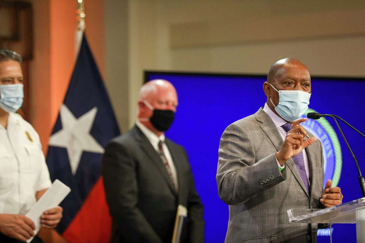 Houston Mayor Sylvester Turner, right, said the city will launch a crackdown on businesses flouting state and local coronavirus restrictions.