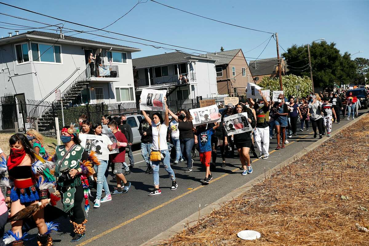 The family of Erik Salgado (center with signs) takes part in a protest march on Bancroft Avenue to memorialize Salgado, who was killed in a CHP officer-involved shooting Saturday night. Photographed in Oakland, Calif., on Monday, June 8, 2020.