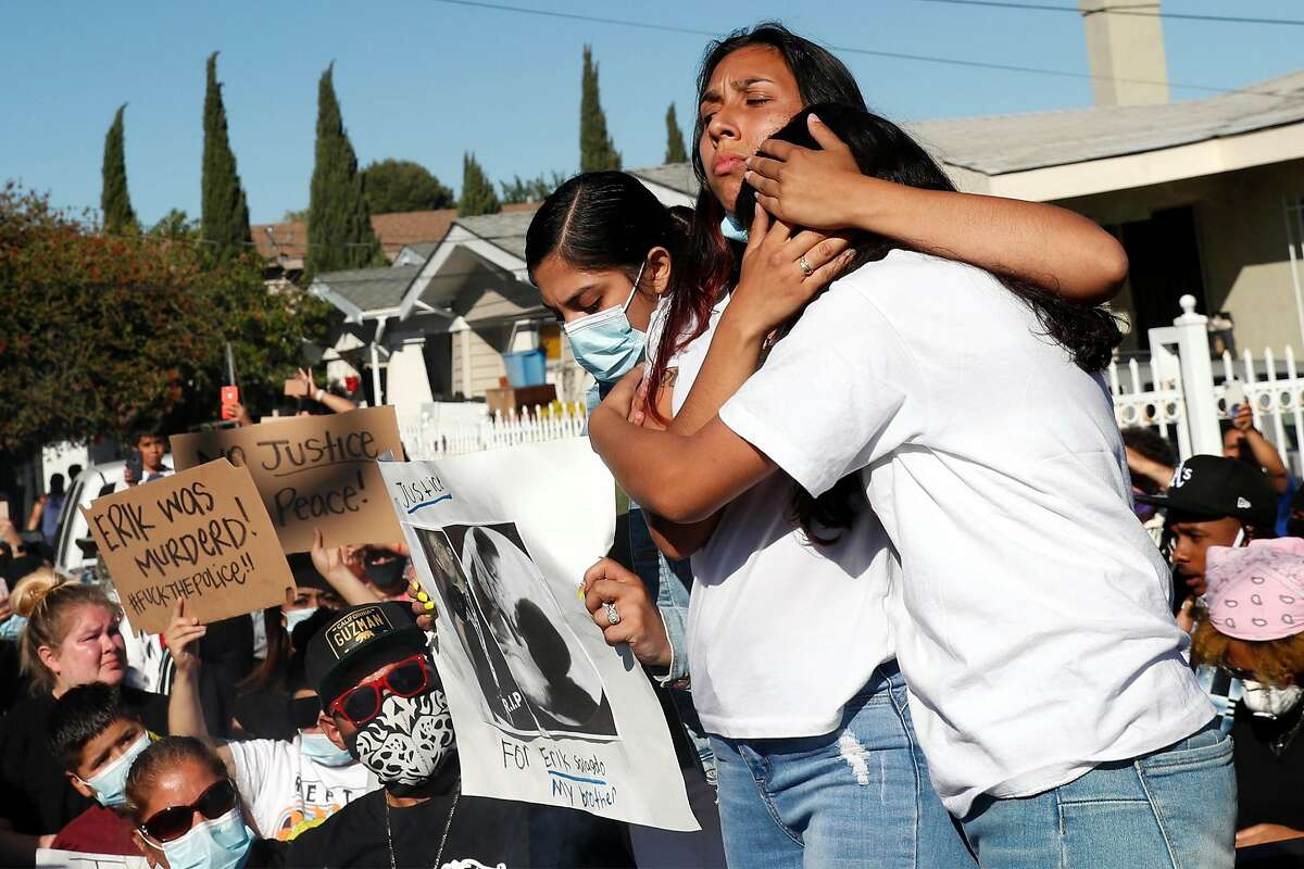 Near the scene of his death, Amanda Majail-Blanco hugs her sister Vanessa after a march to memorialize her stepbrother Erik Salgado, who was killed in a CHP officer-involved shooting Saturday night. Photographed on Cherry Street in Oakland, Calif., on Monday, June 8, 2020.