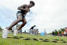Justin Maze gets in footwork as Kelly High School's football team gets in its first practice of the 2020 season Monday morning. It was the first day that team practices were allowed in the state under guidelines issued to schools by TAPPS and UIL. Photo taken Monday, June 8, 2020 Kim Brent/The Enterprise