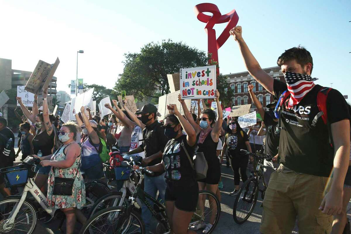 The Young Ambitious Activists group organized Monday's march from the Blue Star Arts Complex to La Villita and Hemisfair Plaza.