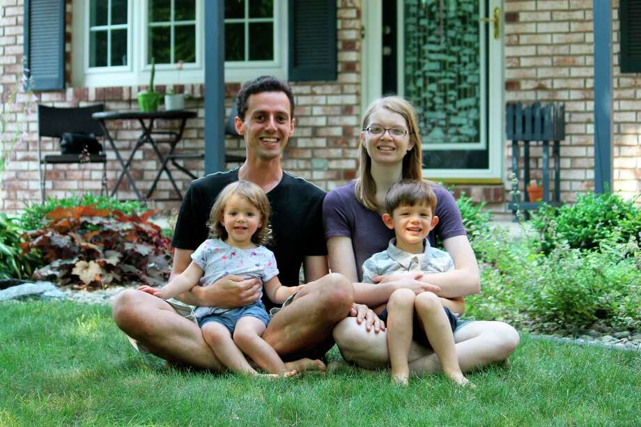 Aurelian Balan with his wife, Alyssa and his children at their home in Midland. Balan, a Delta College associate professor of physics, recently received Delta's highest teaching honor -- The Bergstein Award for Teaching Excellence. (Photo provided)