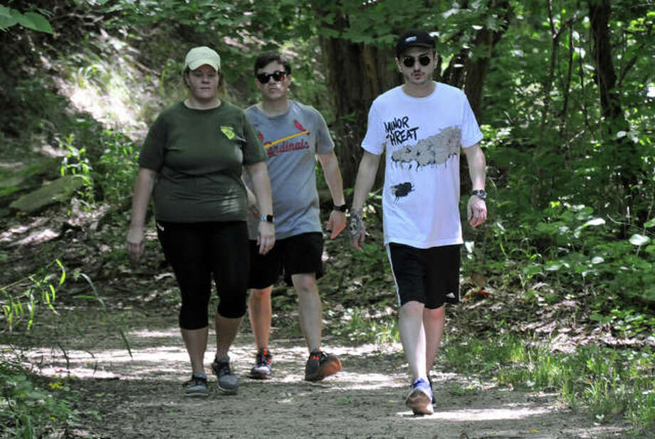 Samantha McKinley, Tyler Ewing and Seth Rollins of Springfield hike the trails at Pere Marquette State Park. Photo: David Blanchette | Hearst Illinois