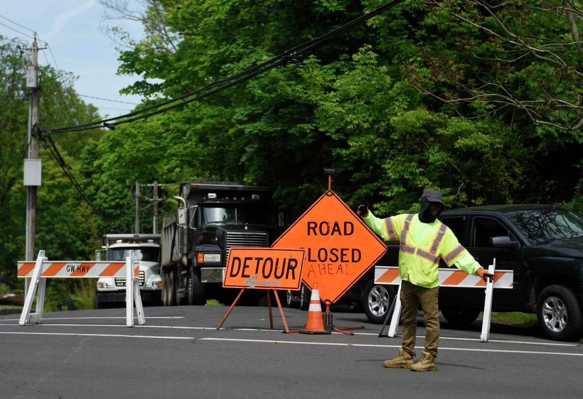 Traffic is redirected as Anderson Road is closed in Greenwich, Conn. Tuesday, May 19, 2020. Anderson Road will be closed again Wednesday between Elm Street and Mallard Drive as crews repair damage from the water main break.