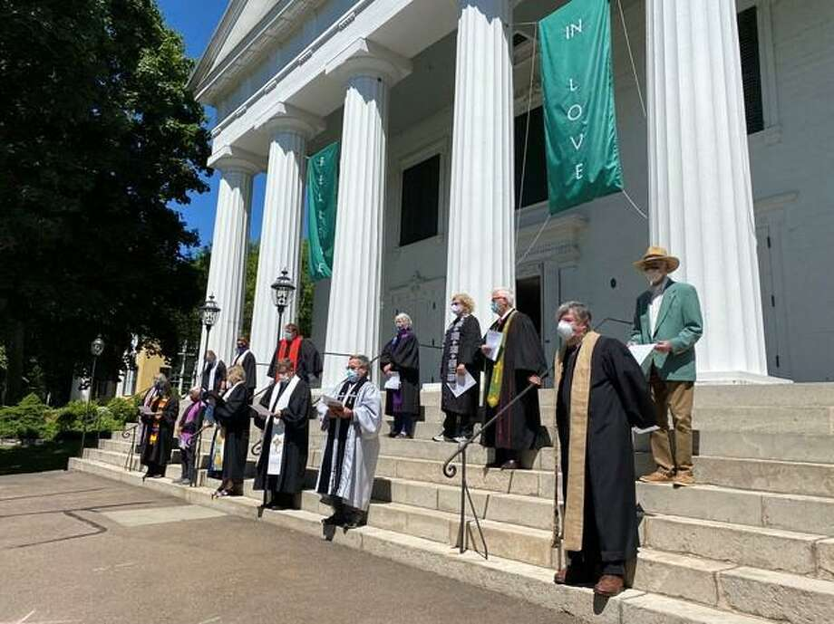 Clergy of the United Church of Christ churches east of New Haven gathered on the steps of the First Congregational Church of Madison on Monday to denounce the killing of George Floyd and other African Americans as well as systemic racism. Photo: Contributed Photo