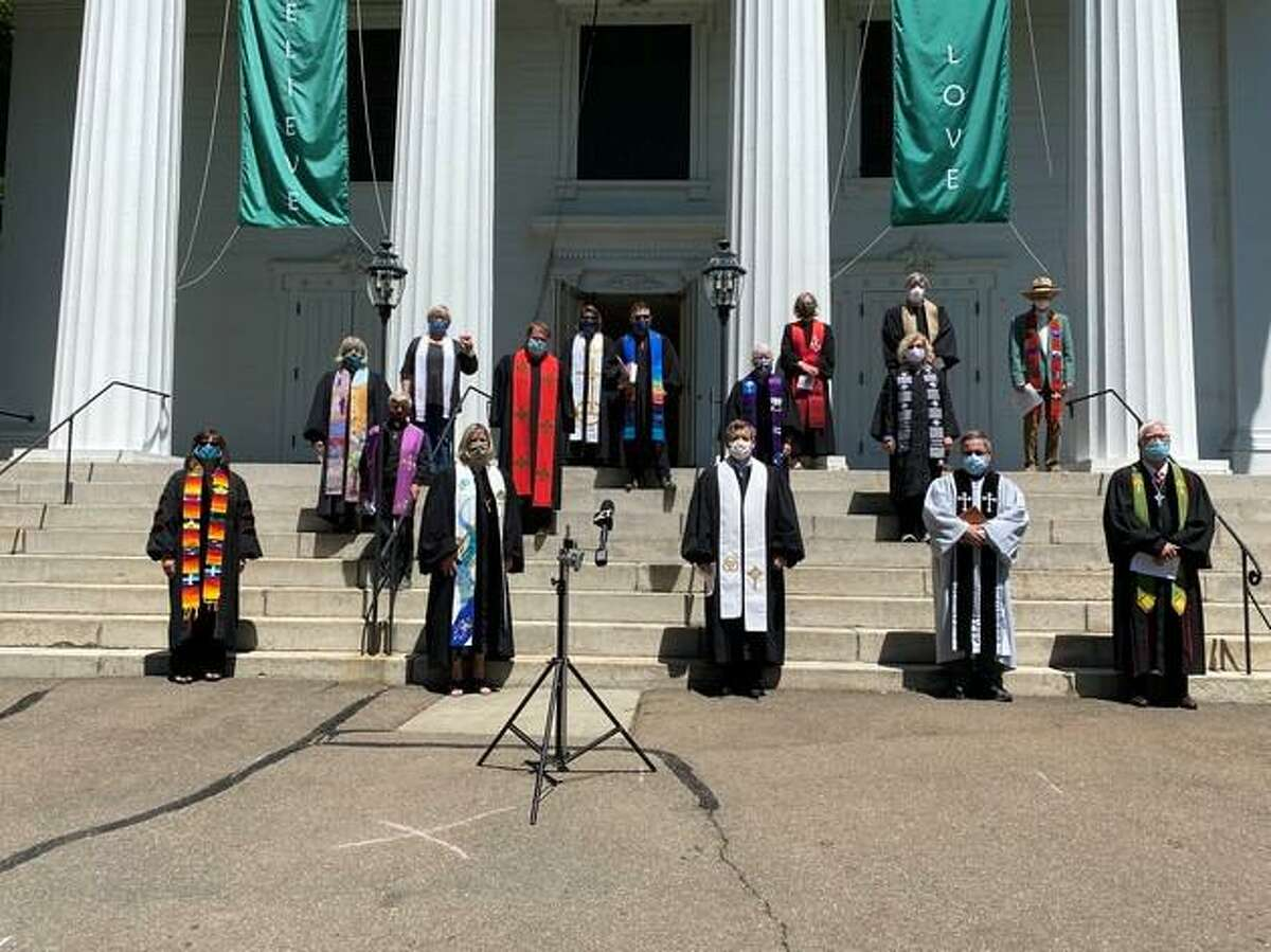Clergy of the United Church of Christ churches east of New Haven gathered on the steps of the First Congregational Church of Madison on Monday to denounce the killing of George Floyd and other African Americans as well as systemic racism.