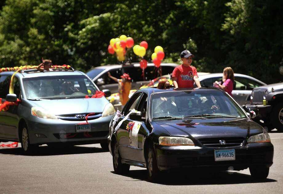 Sunnyside School teachers greet an automobile parade of students and their parents to mark the end of the school year  on Monday. Photo: Brian A. Pounds / Hearst Connecticut Media / Connecticut Post