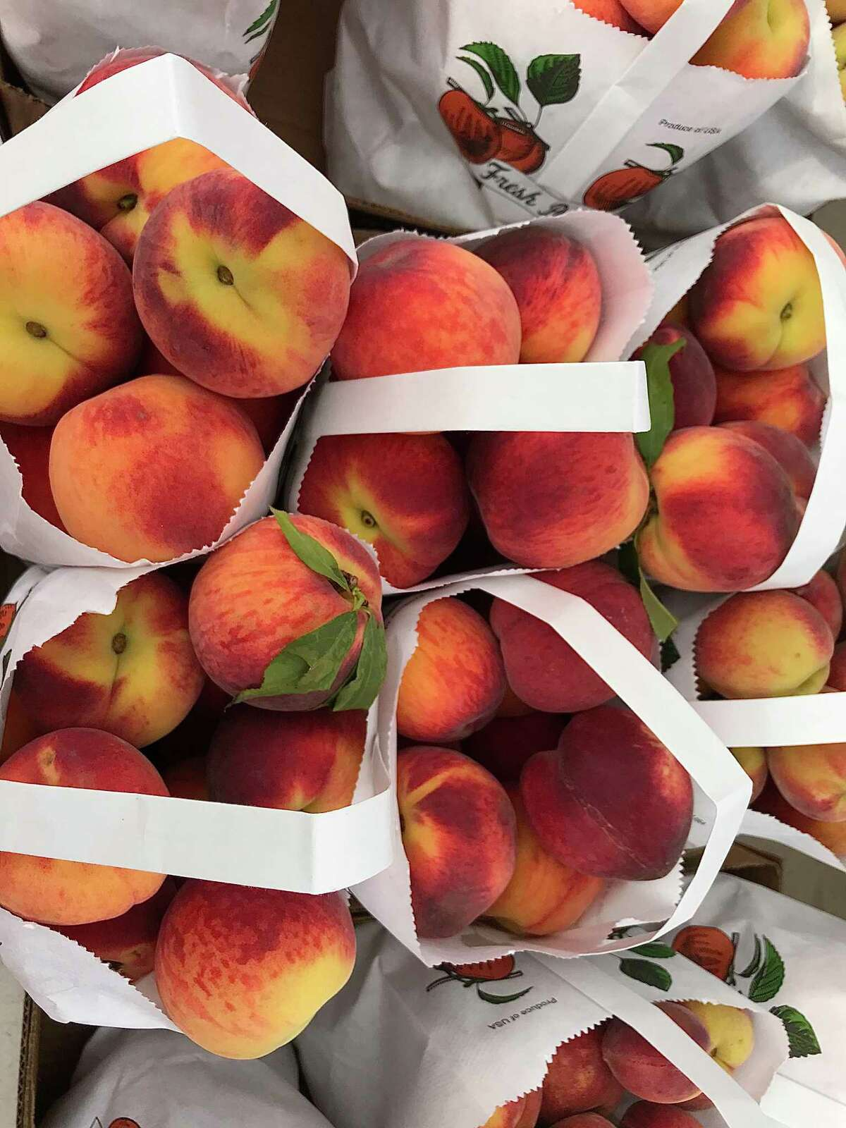 Texas peaches from Lightsey Farms in Mexia are available at the Urban Harvest Farmers Market in Houston.