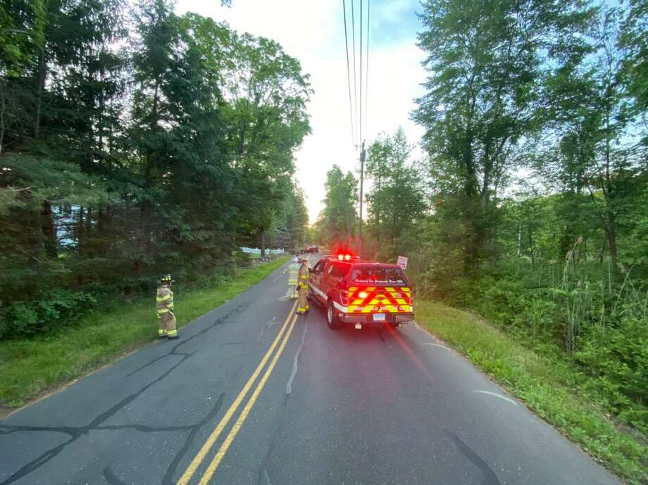 Oak Grove Road in Brookfield, Conn., was shut down after a vehicle crashed into a telephone pole June 8, 2020. Photo: Brookfield Volunteer Fire Department