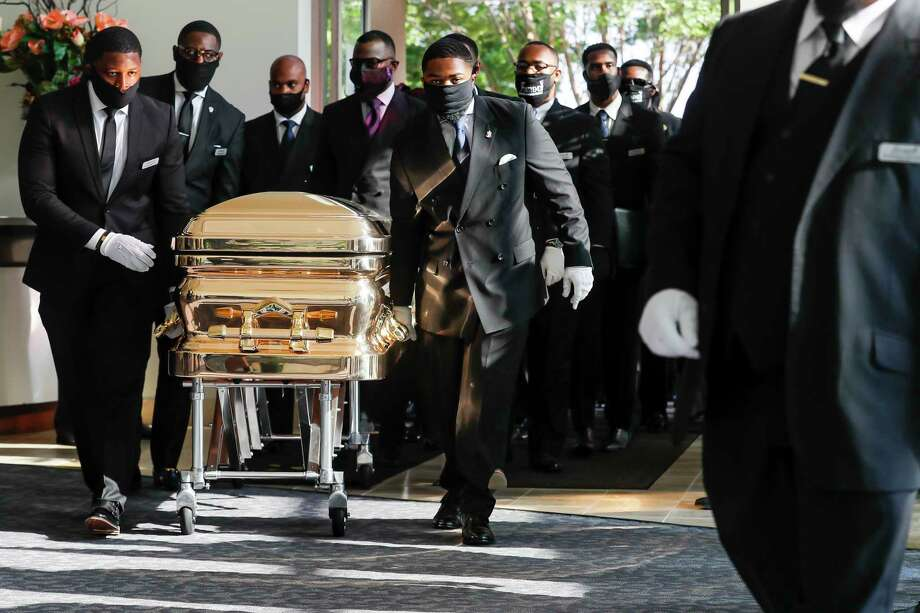 Pallbearers bring the coffin into the church for the funeral for George Floyd on Tuesday, June 9, 2020, at The Fountain of Praise church in Houston. Floyd died after being restrained by Minneapolis Police officers on May 25. Photo: Godofredo A. Vásquez, Houston Chronicle / Copyright 2020 Godofredo A. Vásquez/HOUSTON CHRONICLE. All rights reserved.