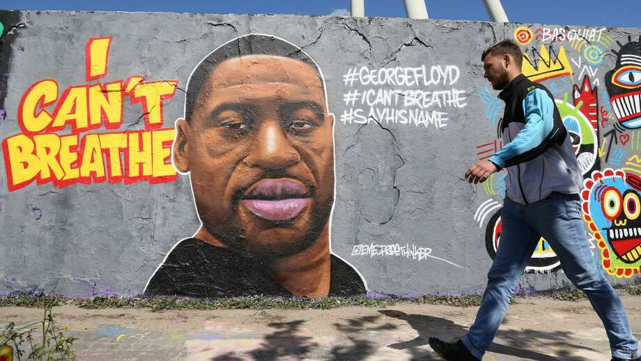 This Berlin, Germany, street art commemorates George Floyd, who was killed in police custody in Minneapolis after footage emerged of him pleading for air as a police officer kneeled on his neck. Photo: Adam Berry/Getty Images / 2020 Getty Images