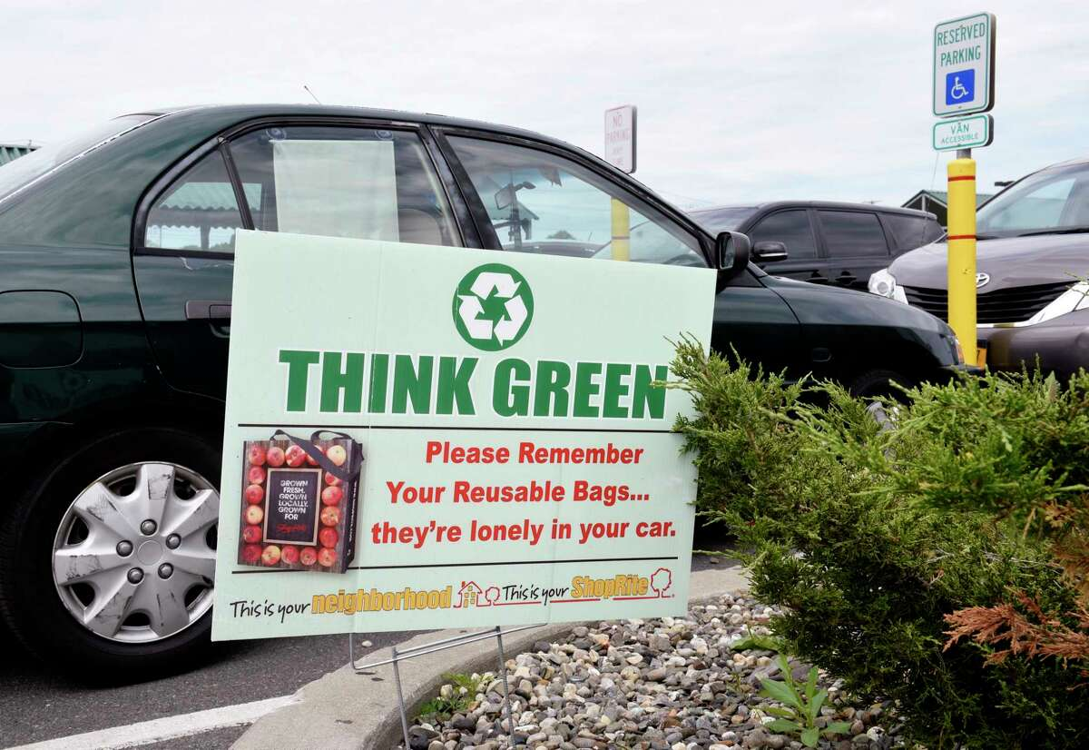 An environmental sign reminding shoppers to use their reusable bags is seen in the parking lot of ShopRite on Tuesday, June 9, 2020 in Albany, N.Y. Environmentalists are pushing the state to implement the plastic bag ban put off when the coronavirus hit. (Lori Van Buren/Times Union)