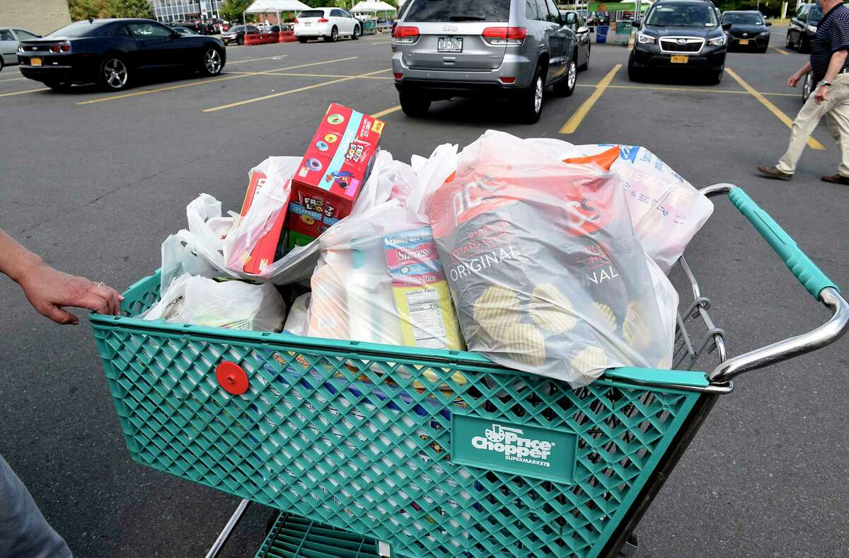 A shopper gets ready to unload her groceries from her cart to her car in the Price Chopper parking lot on June 9, 2020 in Albany, N.Y. A state Supreme Court justice upheld the New York's plastic bag ban but found the Department of Environmental Conservation so badly bungled the rolloutthe plaintiffs were entitled to have the state pay legal cost in the lawsuit. (Lori Van Buren/Times Union)