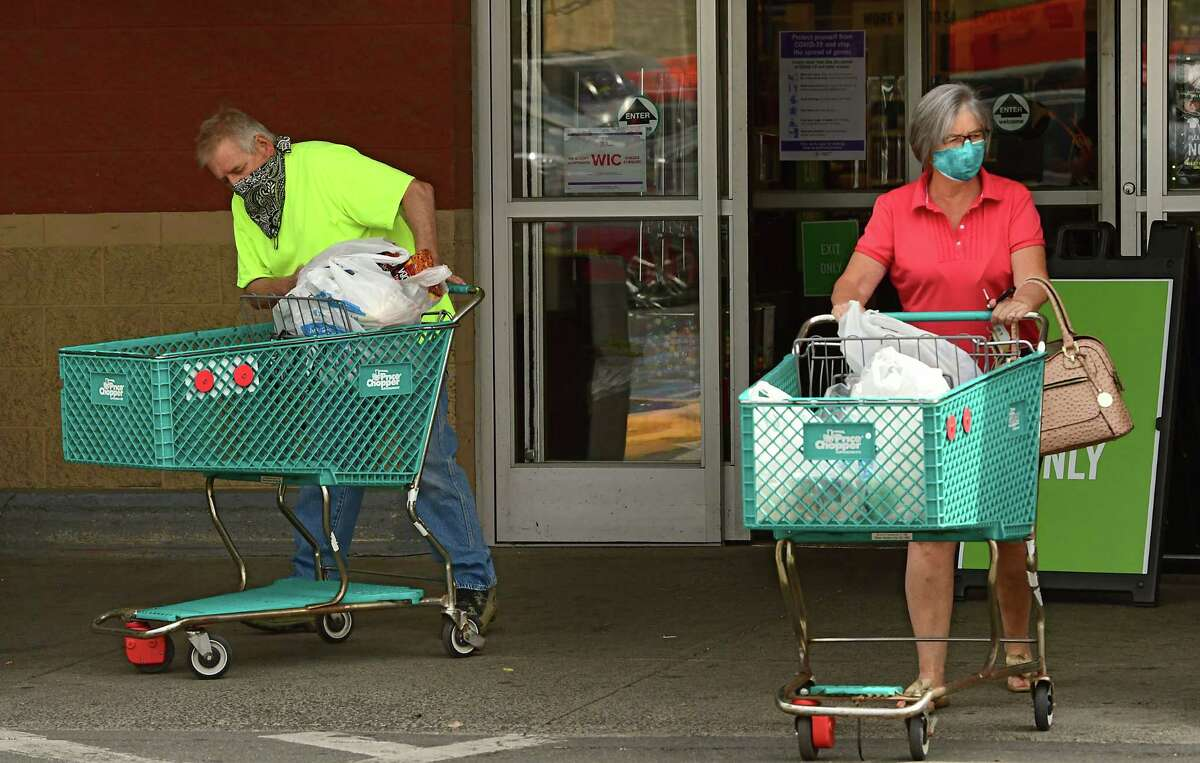 Shoppers leave the Price Chopper on Central Ave. with plastic bags in their carts on Tuesday, June 9, 2020 in Albany, N.Y. Environmentalists are pushing the state to implement the plastic bag ban put off when the coronavirus hit. (Lori Van Buren/Times Union)