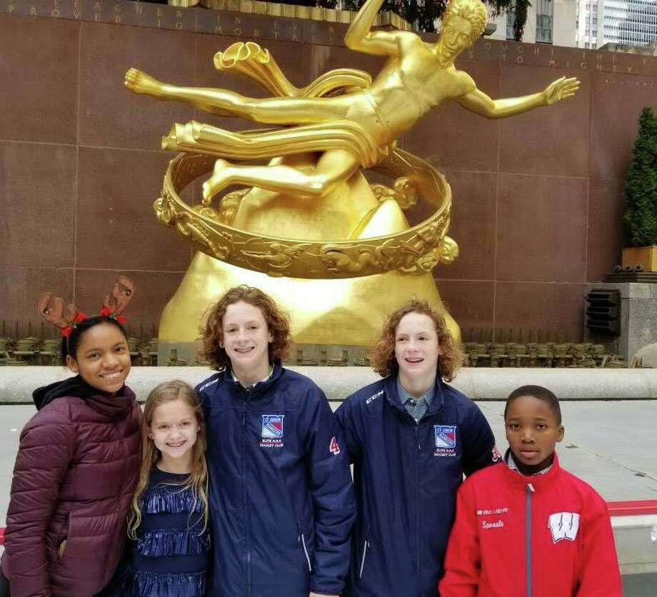Host daughter, Marlene, with her host parent Jennifer Sproule's children, Caroline, Teddy, Andrew, and Michael on a family trip to Rockefeller Center. Photo: Contributed Photo